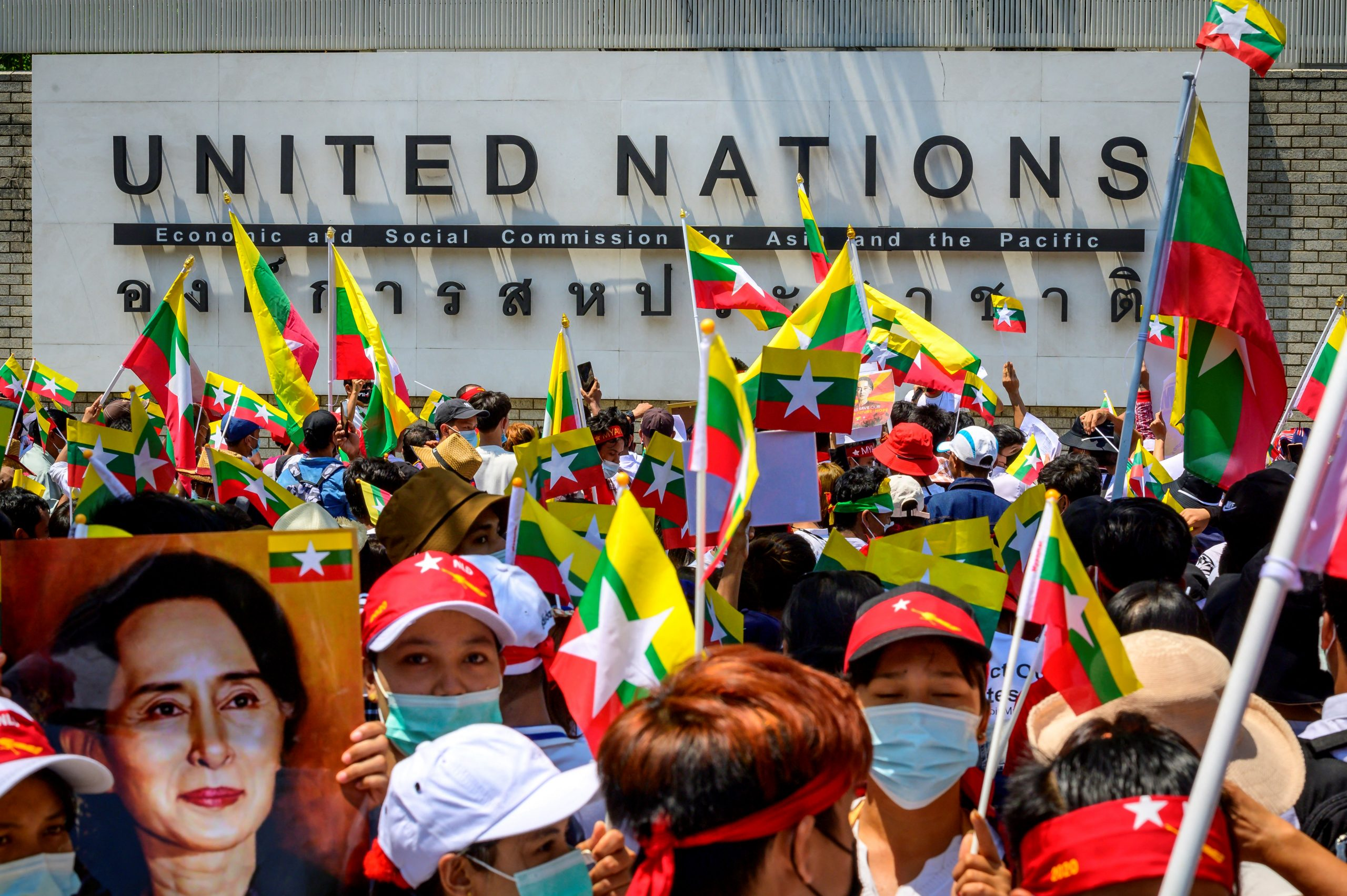 Myanmar migrants in Thailand protesting against the military coup in front of the United Nations ESCAP building in Bangkok on March 7, 2021. (AFP)