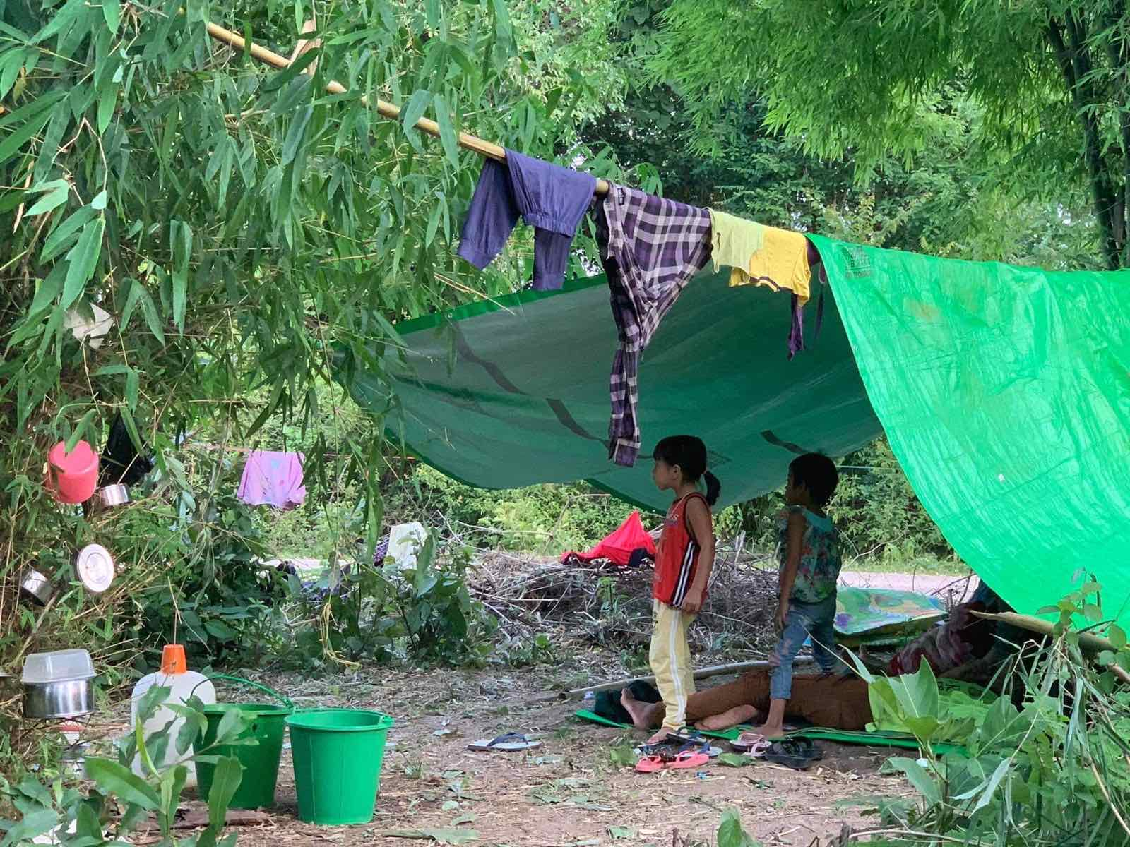 Children under a makeshift dwelling at an IDP camp in Kayah State in June 2021. (Supplied)