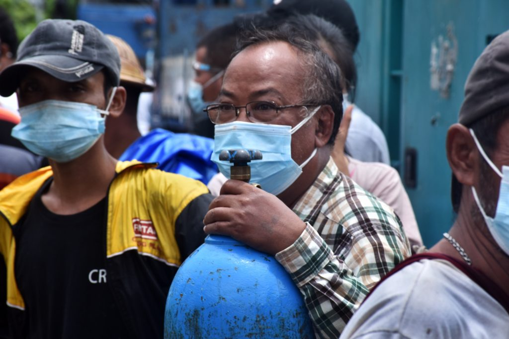 Yangon residents gather at the privately run Matesat oxygen factory in South Dagon Township on July 13. (Frontier)