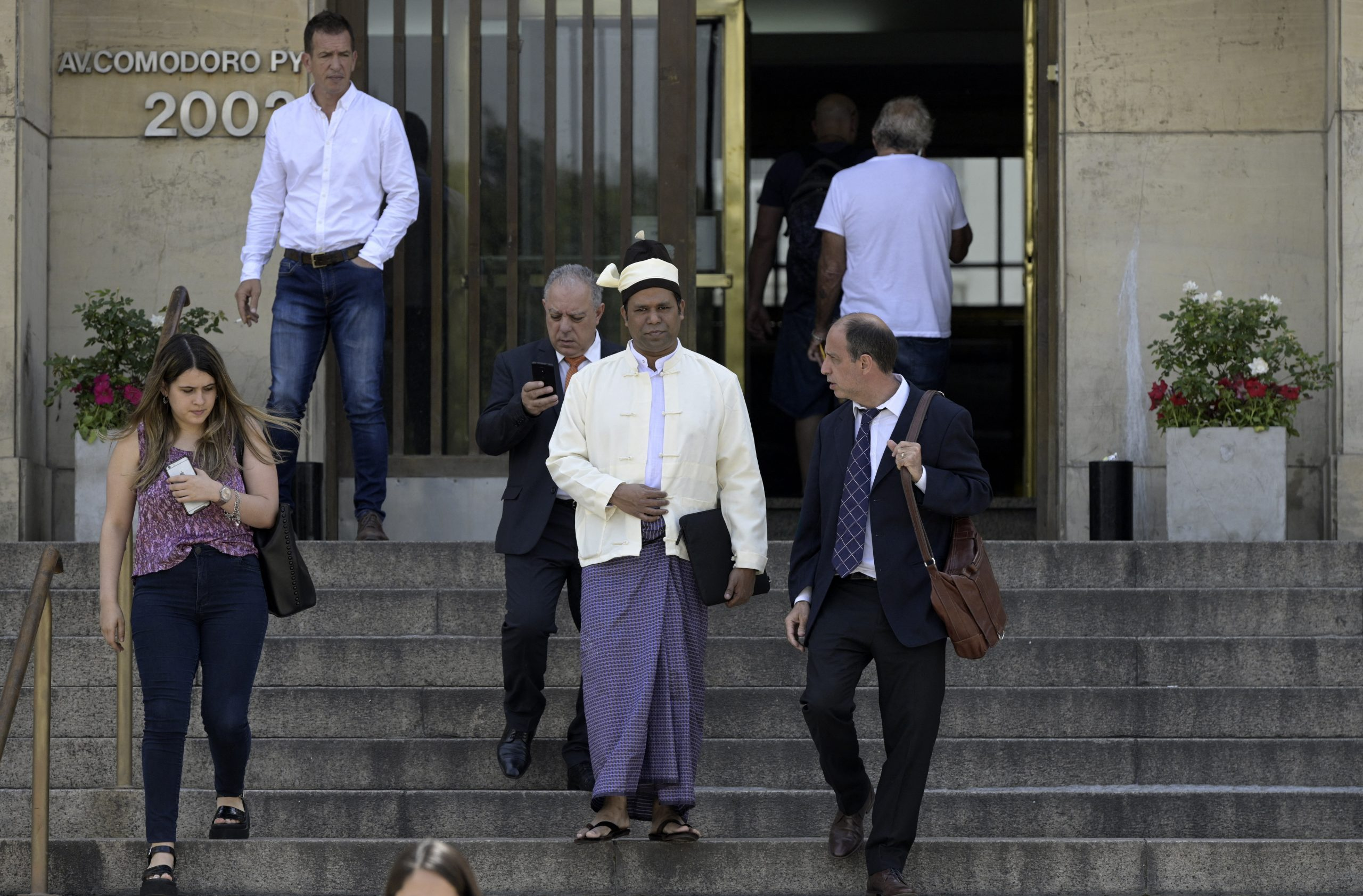The President of The Burmese Rohingya Organisation UK , Tun Khin (L) and Argentine human rights lawyer Tomas Ojea Quintana (R) leave Argentine federal court in Buenos Aires on November 13, 2019. (AFP)