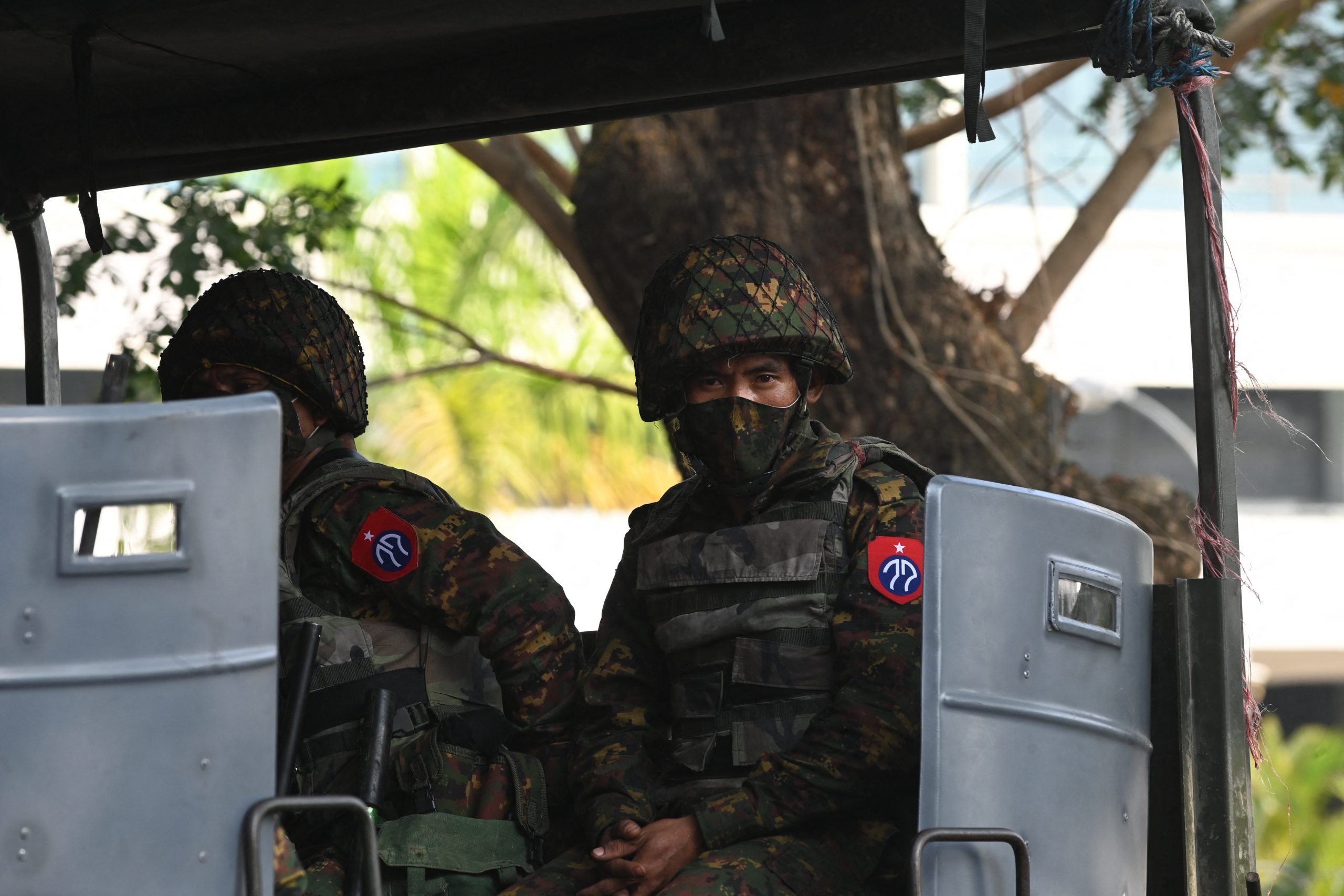Soldiers sit in an army truck outside the Central Bank of Myanmar,in Yangon on February 15, 2021. (AFP)