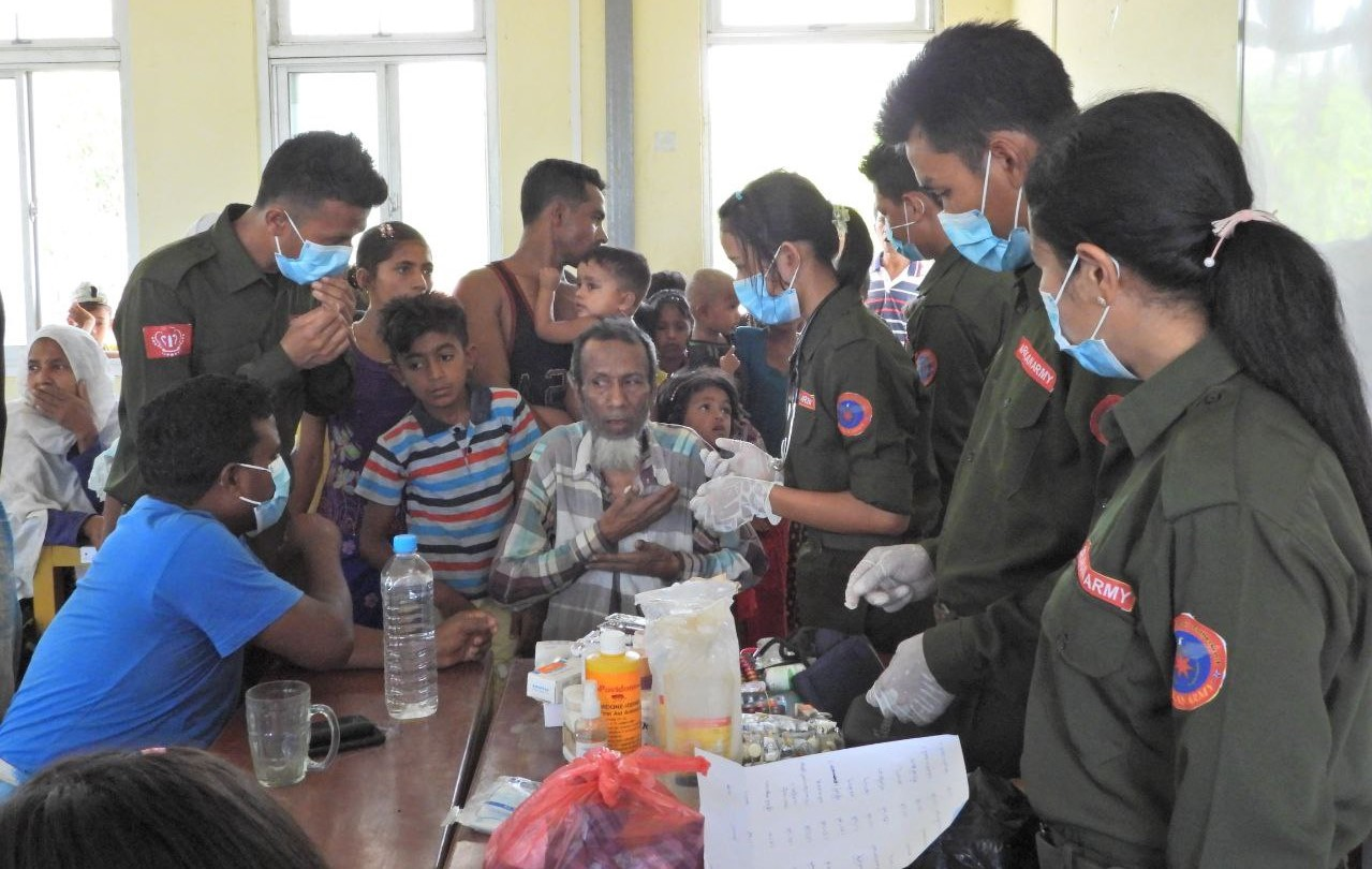 In response to COVID-19 third-wave, a group of medical officers from the Arakan Army did healthcare at Arkataung village's school in Rathedaung township on 19 May 2021. (Supplied)