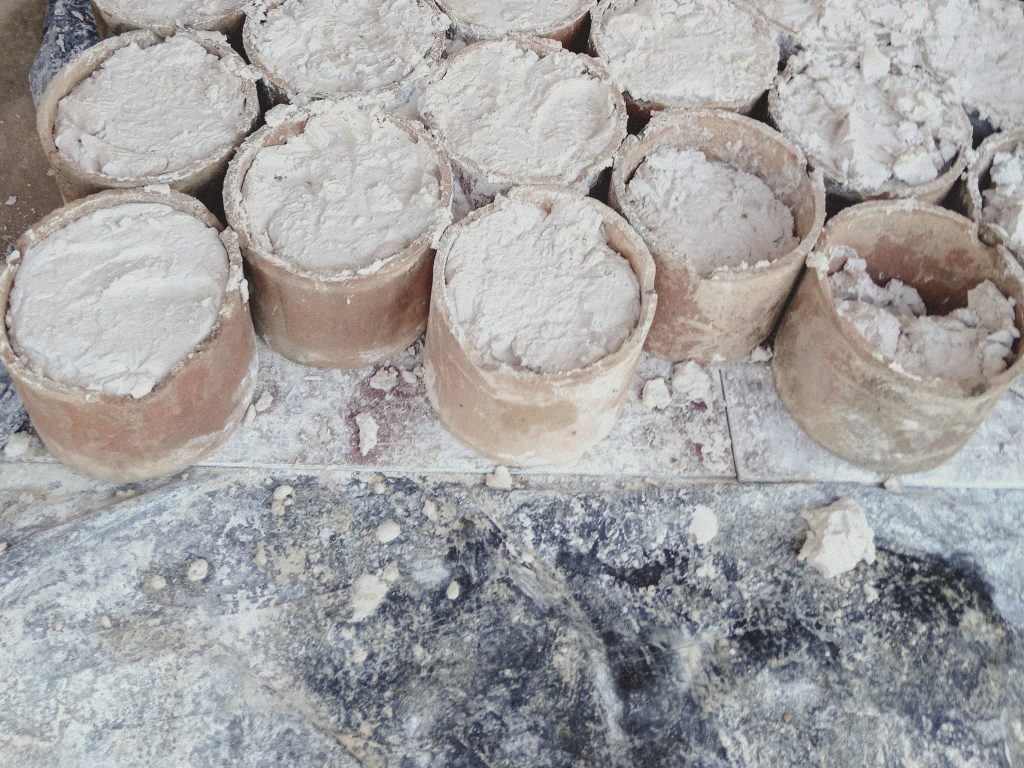 Pots containing rare earths at a mine site near Pangwa in Kachin State's Chipwi Township.