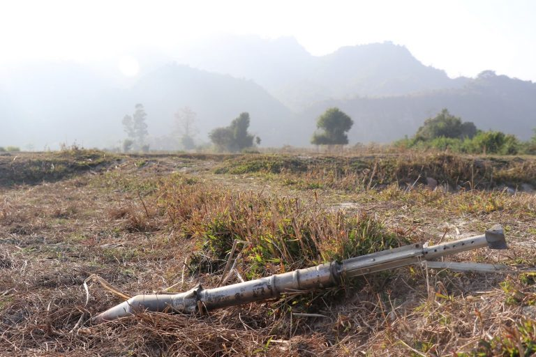 An unexploded ammunition lies on a field in Rakhine State's Rathedaung Township in February 2019, after a fresh round of fighting between the Myanmar military and the Arakan Army, which on Monday confirmed it had abducted three candidates from the ruling National League for Democracy in the south of the state, weeks before the November election. (AFP)