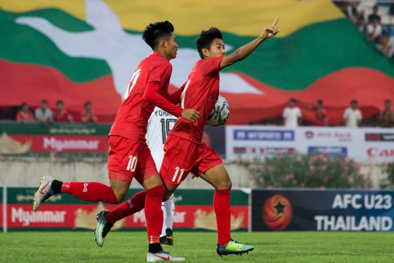 Myanmar's Hein Htet Aung, right, celebrates scoring during the Tokyo 2020 Olympic Games men's Asian qualifier football match between Myanmar and East Timor in Yangon on March 22, 2019. (AFP)