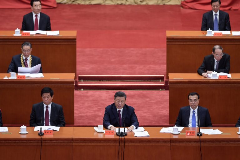 Chinese President Xi Jinping, center, delivers a speech at the Great Hall of the People in Beijing on September 8. (AFP)