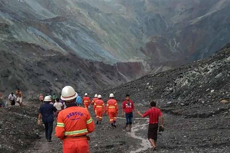 This handout from the Myanmar Fire Services Department taken and released on July 2, shows rescuers attempting to locate survivors after a landslide at a jade mine in Hpakant, Kachin State. (AFP | Myanmar Fire Services Department)