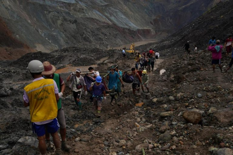 Rescuers recover bodies near the landslide at the jade mining site in Hpakant, Kachin State on July 2. (AFP)