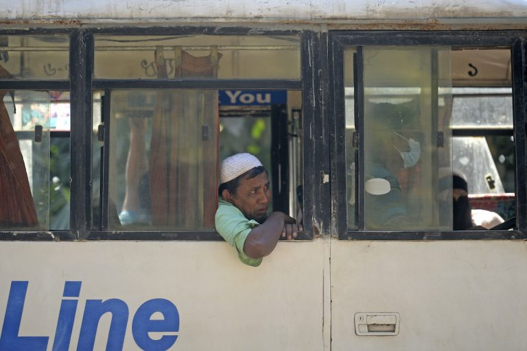 Rohingya refugees are being transported in a bus to Chittagong district from a refugee camp for the first mass relocation of refugees to an island prone to cyclones and flooding in Ukhia on December 3. (AFP)