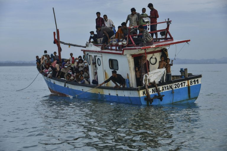 A boat carrying Rohingya migrants arrives on the shores of Lancok village, in Indonesia's North Aceh Regency, on June 25, 2020. (AFP)