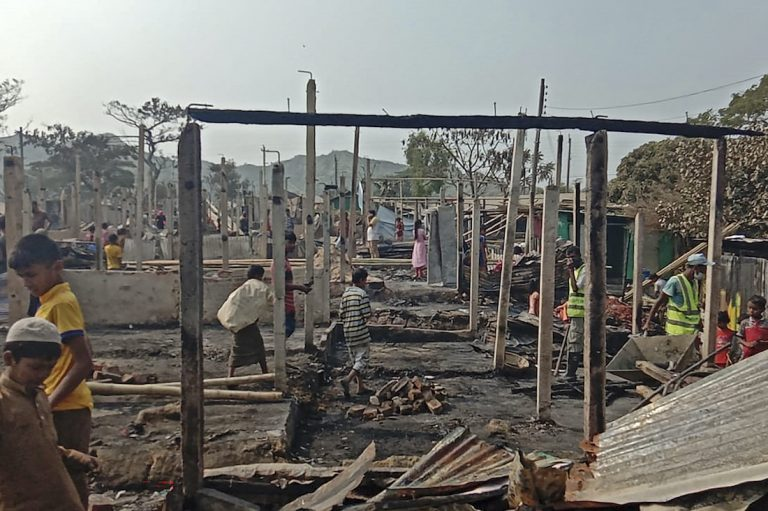 Rohingya refugees search for their belongings after a fire broke out at Nayapara refugee camp in Teknaf on January 14, 2021. (AFP)