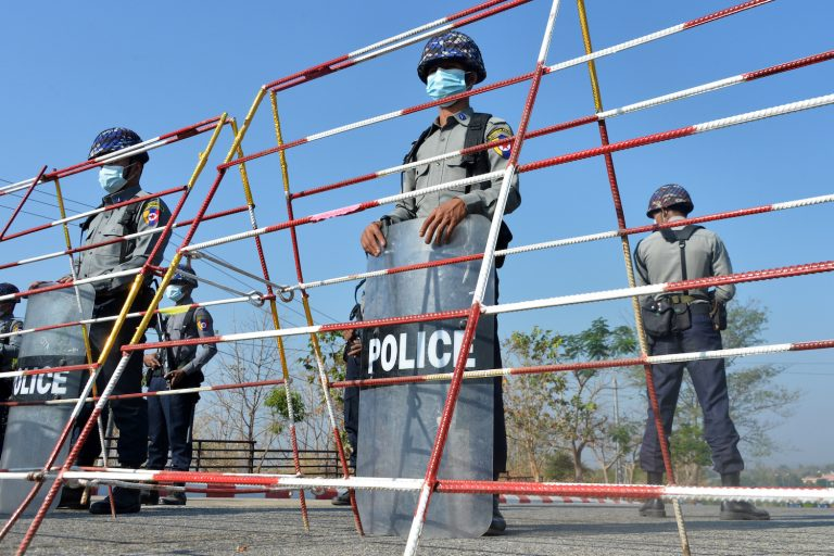 Police stand guard along a road in Nay Pyi Taw on January 29 ahead of the opening of the lower house of parliament on February 1. (AFP)