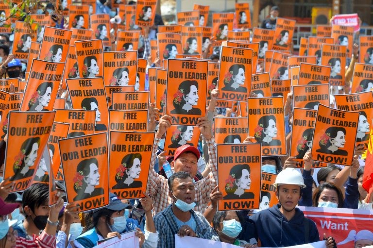 Protesters hold posters with the image of detained civilian leader Daw Aung San Suu Kyi during a demonstration against the military coup in Nay Pyi Taw on February 28. (AFP)