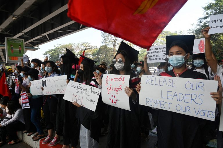 Protesters in school graduation clothing take part in a demonstration against the military coup in Yangon in February. (Frontier)