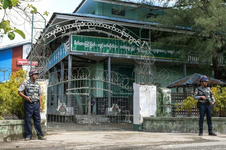 Armed police are posted at the entrance of a school in Sittwe, capital of western Rakhine State on June 1, 2021. (AFP)