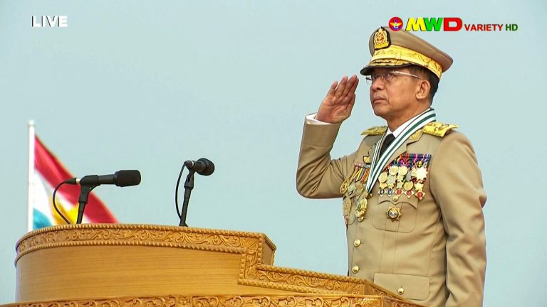 Screengrab of March 27, 2021 broadcast of Senior General Min Aung Hlaing saluting during an annual parade put on by the military to mark Armed Forces Day in Naypyidaw.(MRTV/AFP)