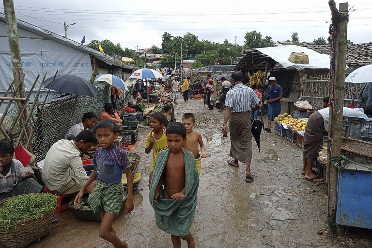 Rohingya refugees walk along a path at Kutupalong refugee camp in Ukhia on August 25, 2021. (AFP)