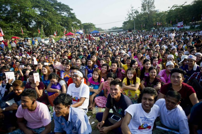 Ethnic Rakhine people listen to an Arakan National Party campaign speech for the November election in Yangon on October 25. (AFP)