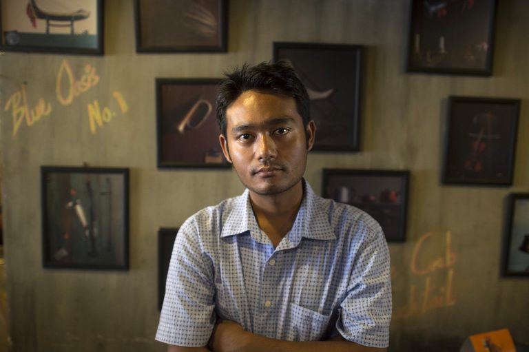 This picture taken on March 28, 2017 shows poet and freedom of expression activist Maung Saungkha posing in Yangon. On September 4 a verdict will be announced in the government's case brought against him under the Peaceful Assembly Law for protesting an ongoing internet blackout in northern Rakhine State. (AFP)