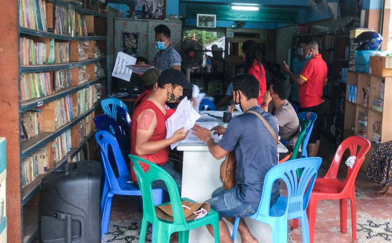 Staff of the Migrant Workers Rights Network in Samut Sakhon sort through advance vote applications by migrant workers ahead of the August 5 deadline. (Supplied)