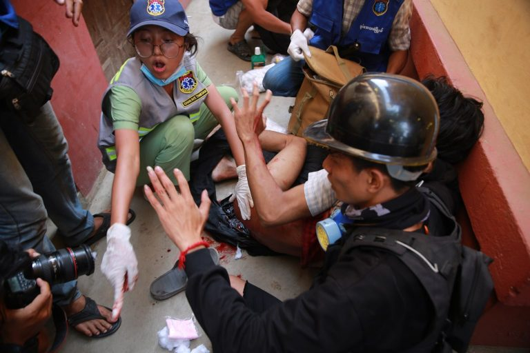 A volunteer medical worker frantically tries to save a person shot by security forces in Mandalay's Maha Aung Myay Township this afternoon. (Frontier)