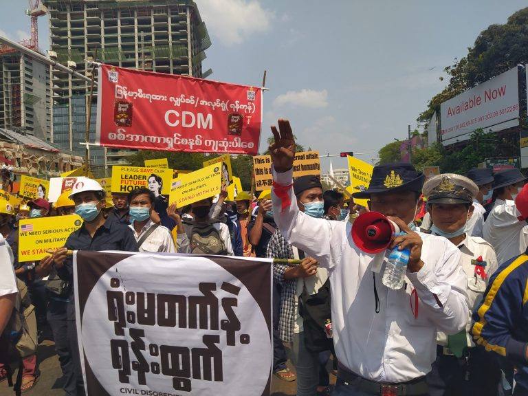 Protesters gather to denounce military rule at the junction of Sule Pagoda and Bogyoke Aung San roads in downtown Yangon. (Frontier)
