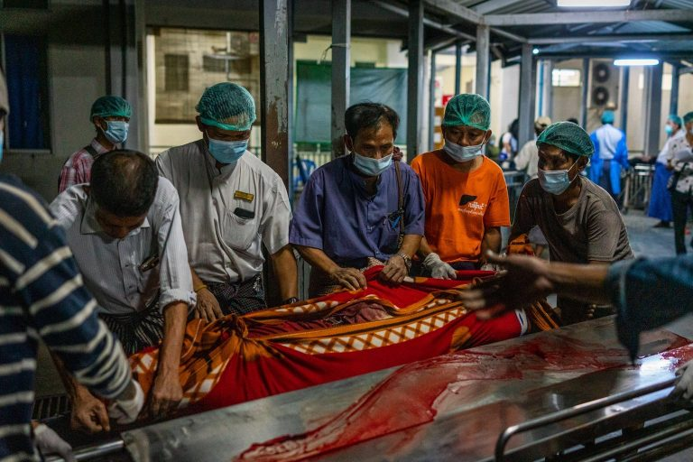 Workers at North Okkalapa Hospital carry the body of a person killed by security forces during a protest today. (Frontier)