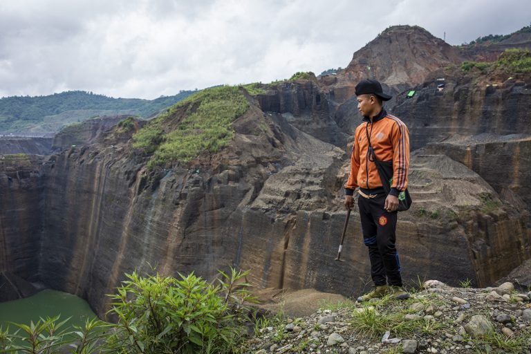 Gum Jat, 31, looks over a jade mining site in Hpakant, Kachin State, where he has worked as a freelance miner for eight years. (Hkun Lat | Frontier)