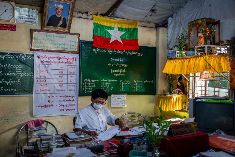 Administrator U Aung Myint at work in his office in Kyun Taw-North ward, in Yangon's Sanchaung Township, on January 14. (Hkun Lat | Frontier)