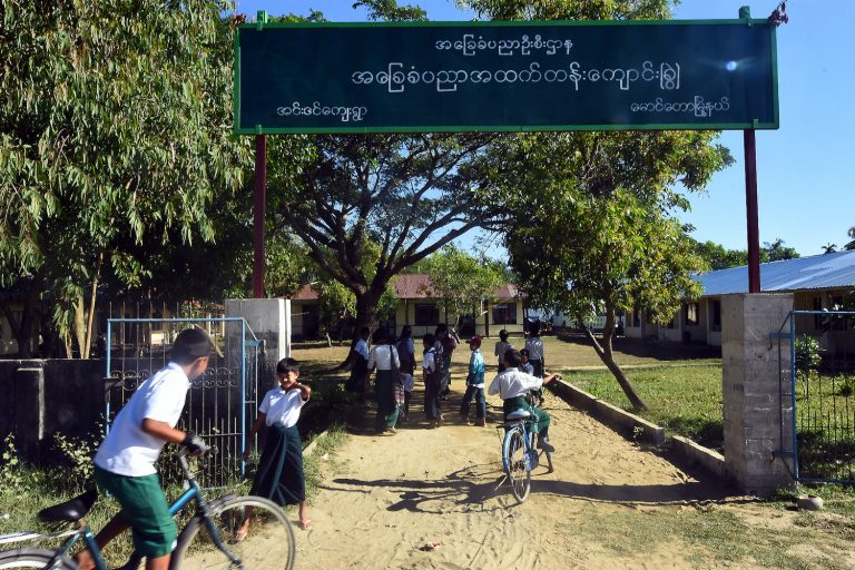Children arrive at a school in Inn Din village, Maungdaw Township, in November 2018. (Steve Tickner | Frontier)
