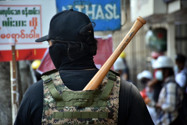 Anti-coup protester carrying a bat (Frontier)