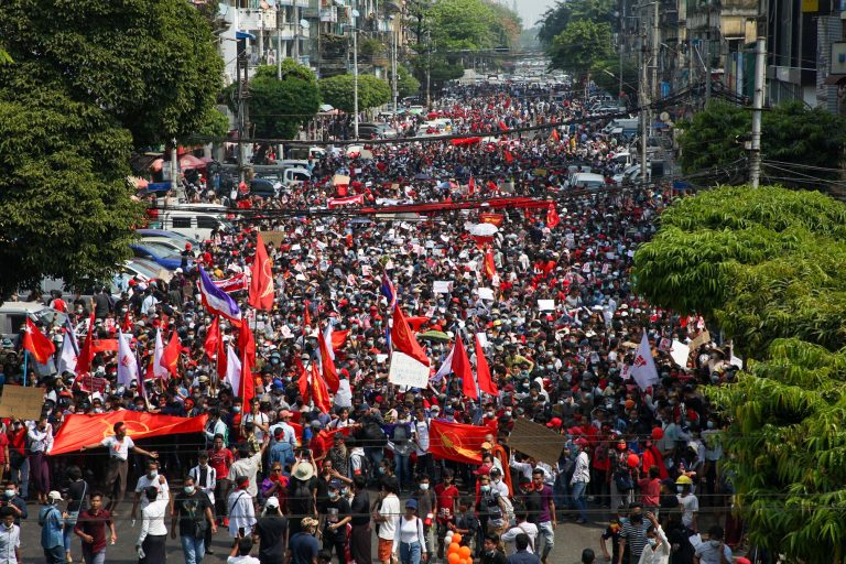 Tens of thousands of marchers from across the city converged near downtown Yangon's Sule Pagoda Saturday in protest against the February 1 military coup, and to demand the release of State Counsellor Daw Aung San Suu Kyi and the resotration of representative government. (Frontier)