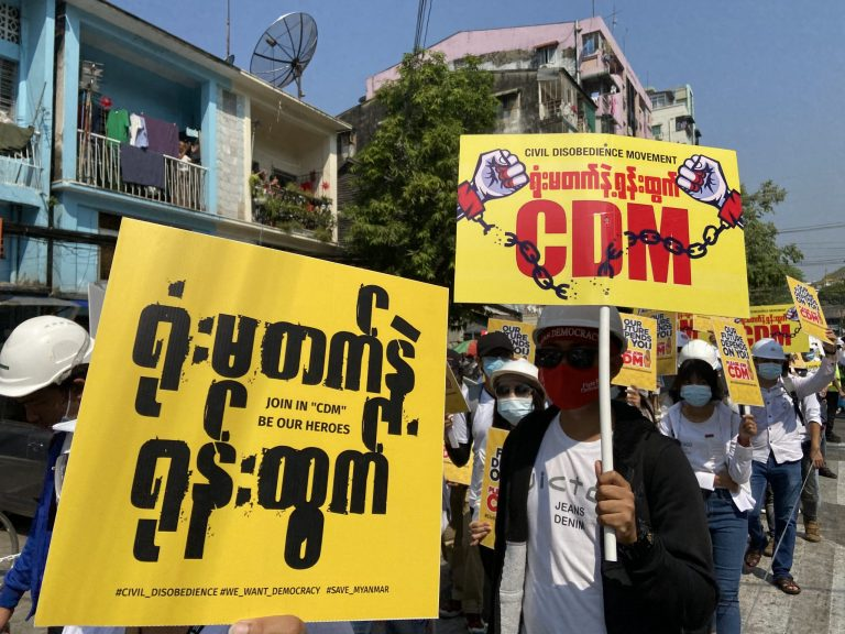 Protesters in Yangon hold placards in support of the Civil Disobedience Movement on February 24. (Frontier)