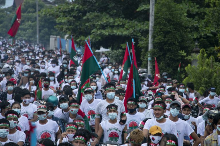 Supporters of the Kachin State People's Party march in a campaign rally in the state capital of Myitkyina on October 17. (Zau Ring Hpra)