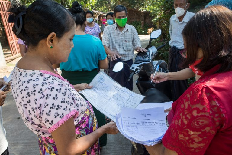 NLD staff survey residents of Yangon Region's Hmawbi Township on November 26, after complaints arose over which households did or did not receive payouts under the government's COVID-19 cash relief programme. (Thuya Zaw | Frontier)