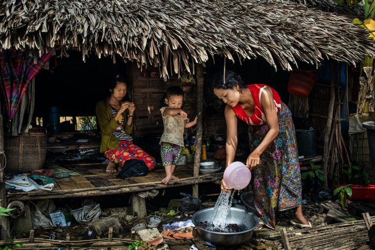 A woman washes clothes at a camp for internally displaced persons in Myothit monastery in Mrauk-U, Rakhine State on August 21. (Hkun Lat | Frontier)