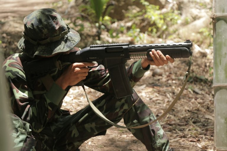 An anti-coup activist aims a weapon while undergoing basic military training in territory controlled by the Karen National Union in southeastern Myanmar. (AFP)