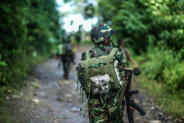 Kachin Independence Army soldiers patrol near the armed group's headquarters of Laiza in January this year. (Yawng Htang)