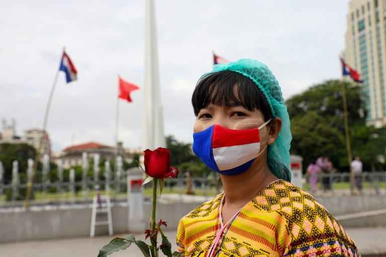 A woman wearing a face-mask with the colours of the Karen national flag at a Karen Martyrs' Day ceremony in Yangon on August 12 this year. (Thuya Zaw | Frontier)