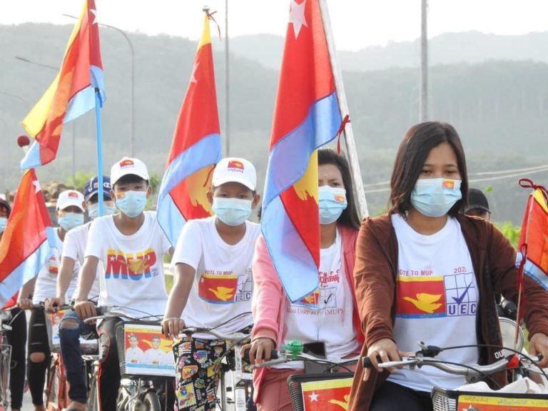 Mon Unity Party supporters cycle down a street in Chaungzon Township, on Mon State's Bilu Island, near the state capital, Mawlamyine on November 4. (Supplied/Nai Mon)