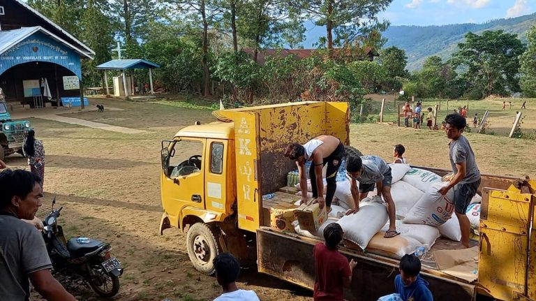 Scarce supplies for people displaced by conflict are unloaded on May 24 at a camp set up in a church compound in Lukse village of Mindat Township. (Supplied)