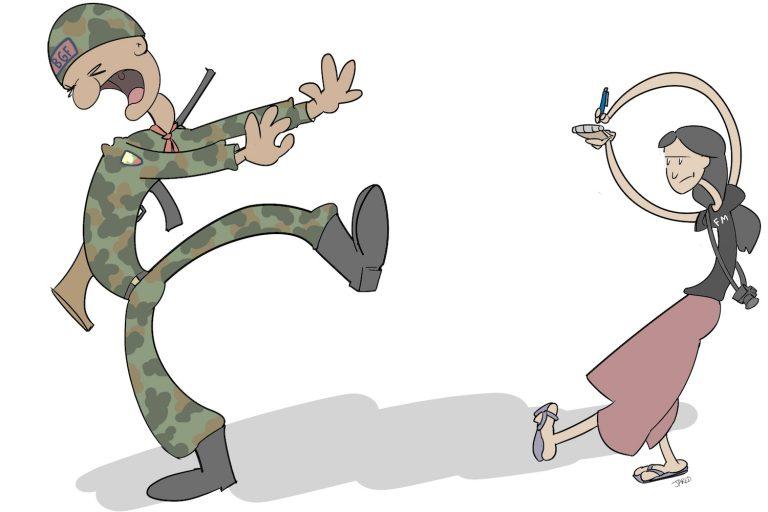 A reporter and a soldier from the Kayin State Border Guard Force.