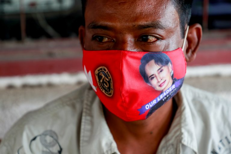 A Pyawbwe local wears a face-mask that commemorates National League for Democracy chair Daw Aung San Suu Kyi's 75th birthday earlier this year. (Nyein Su Wai Kyaw Soe | Frontier)