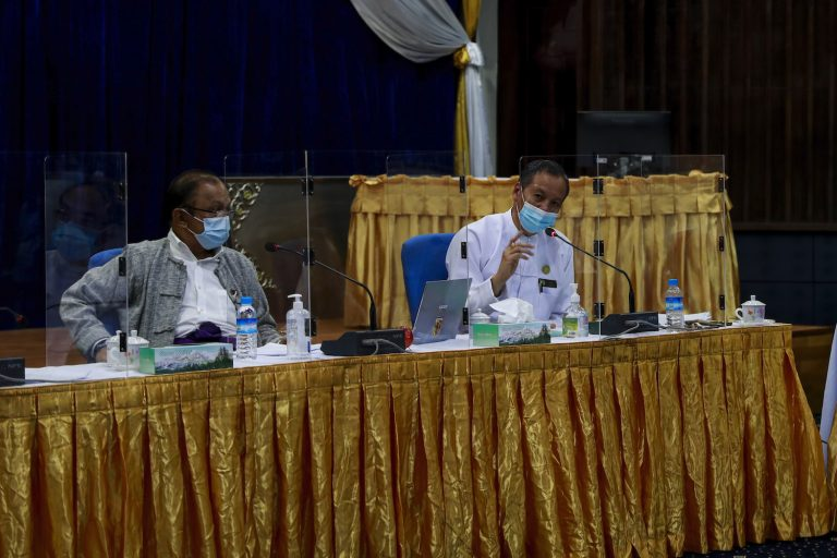 Director General of the Department of Medical Research Dr Zaw Than Tun, right, speaks at a conference on the use of convalescent plasma to treat COVID-19 on August 20, as Dr Rai Mra listens. (Nyein Su Wai Kyaw Soe | Frontier)