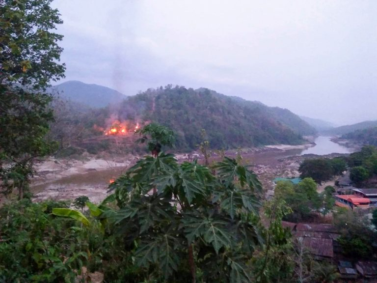 A Myanmar army base burns on a bank of the Thanlwin (Salween) River, as seen on April 27 from Mae Sam Laep town in Thailand's Mae Hong Son province, after the base was captured by KNU soldiers. (Kawthoolei Today / AFP)