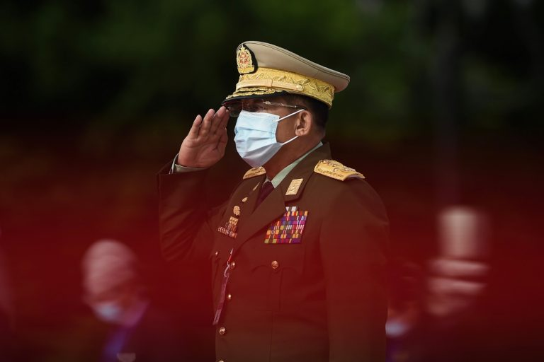 Senior General Min Aung Hlaing salutes during a Martyrs' Day ceremony in Yangon on July 19, 2020. (AFP)