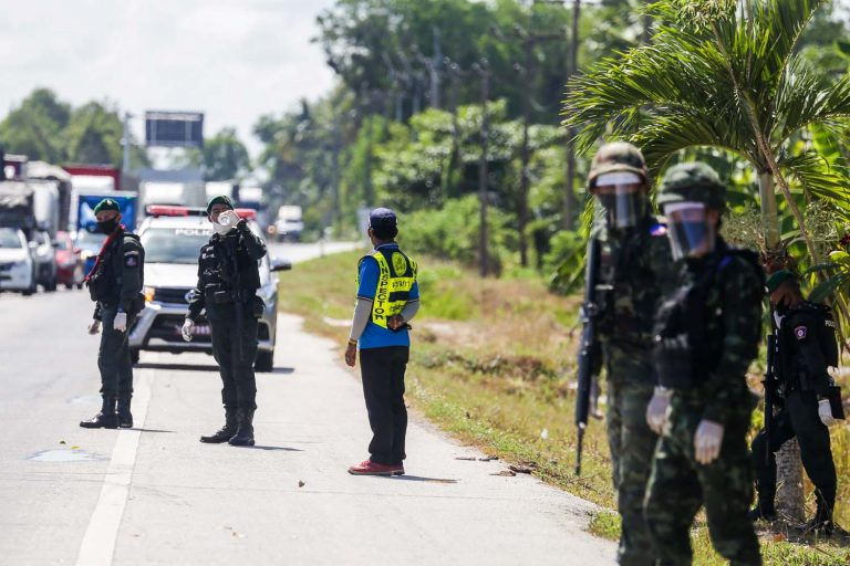Thai government security personnel guard a highway checkpoint in Thailand's southern province of Pattani in April after the country went into lockdown. (AFP)