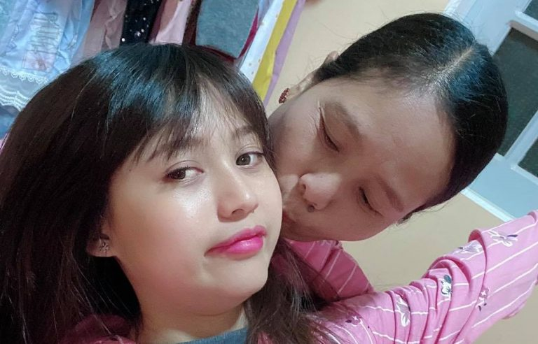 Daw Thandar Aye kisses her daughter, Facebook celebrity Thaw Thaw. After junta forces were unable to find Thaw Thaw, they arrested Thandar Aye and continue to hold her without charge. (Supplied)