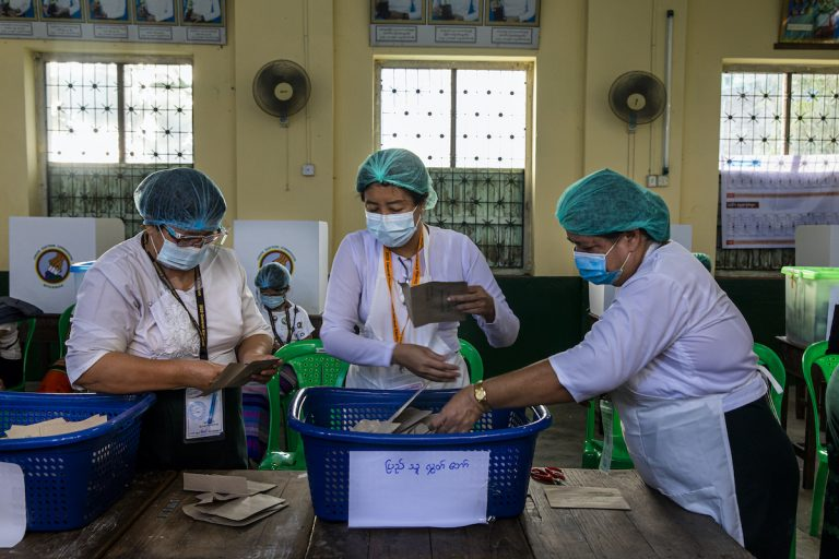 Union Election Commission officials prepare to count advance ballots at the No 5 polling station in Yangon's Mingalar Taung Nyunt Township on November 8. (Hkun Lat   Frontier)