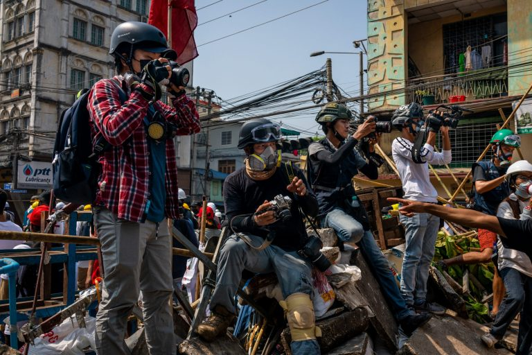 Journalists covering an anti-coup protest in Yangon's Insein Township on March 2 are seen moments before a crackdown by security forces. (Frontier)